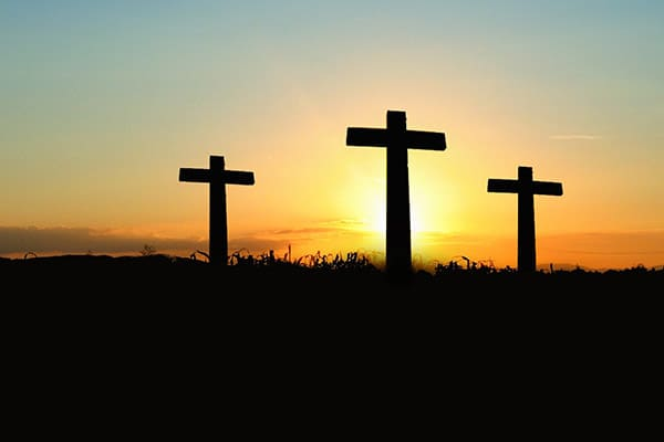 silhouette-photo-of-3-cross-under-the-blue-sky-600x400